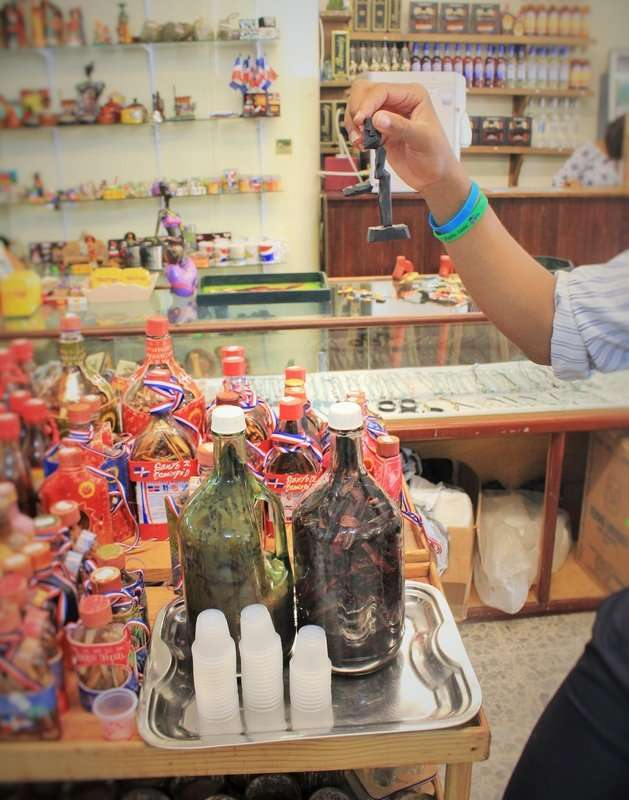 "Oh, Mamajuana. ""It makes the guys do this,"" as the clerk flicks the small wood on the statue. AKA Dominican Viagra. Its a cure all for everything!!! A mixture of honey, rum, and wine cures inside the bottles soaking bark and leaves. And, yes, I did buy a bottle. For medicinal purposes of course."