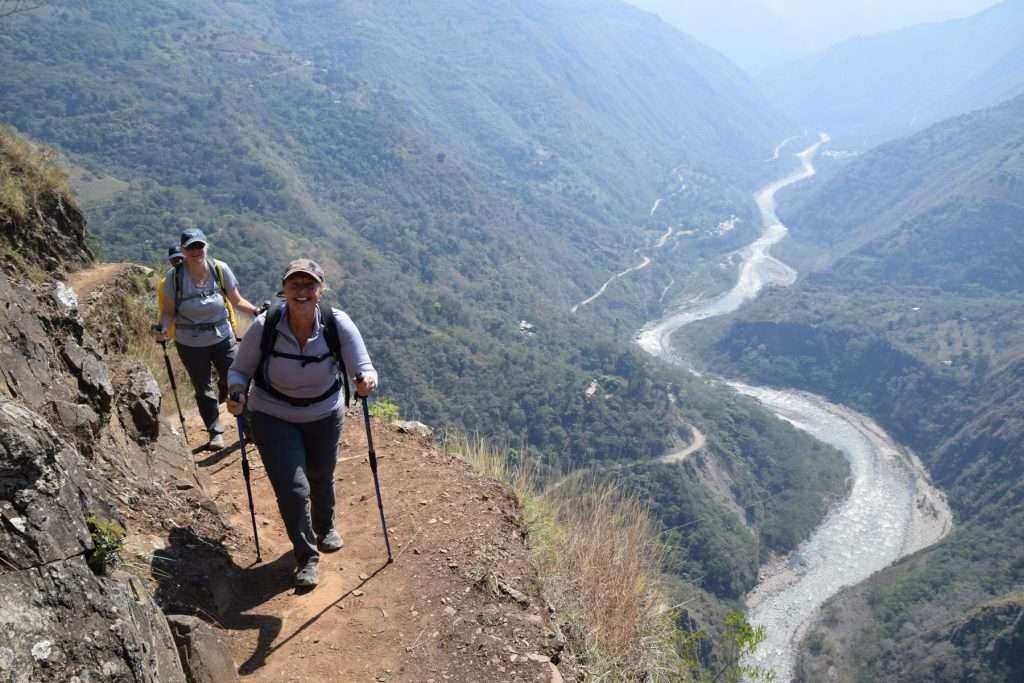 Hiking a section of the Inca Trail on the Machu Picchu and Rainbow Mountain adventure.
