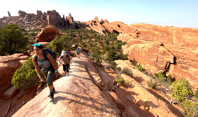 Women hiking in Arches National Park.