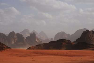 A desert landscape with mountains in the distance