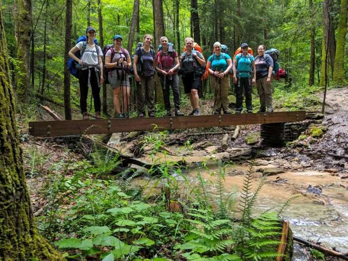 group of women learning how to backpack in the outdoors