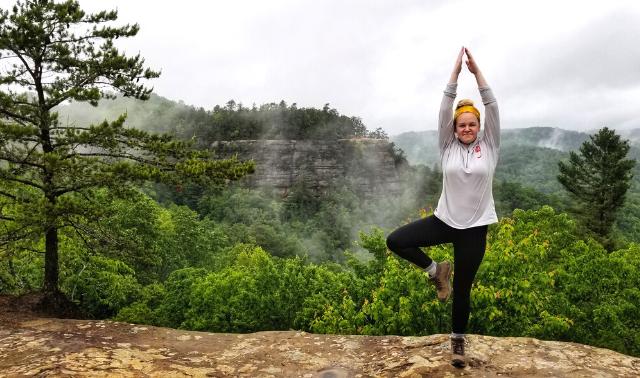 Woman doing a yoga pose on the Appalachian Trail.