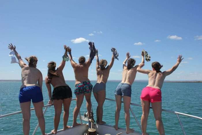 A group of women standing on the bow of a small cruise ship in Baja Mexico