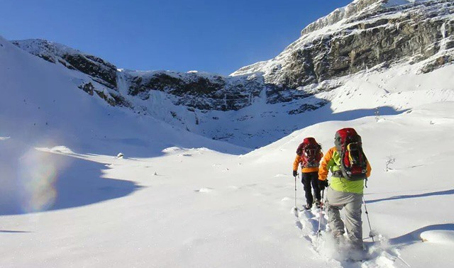 Women backpacking in the snow in Banff, Canada.